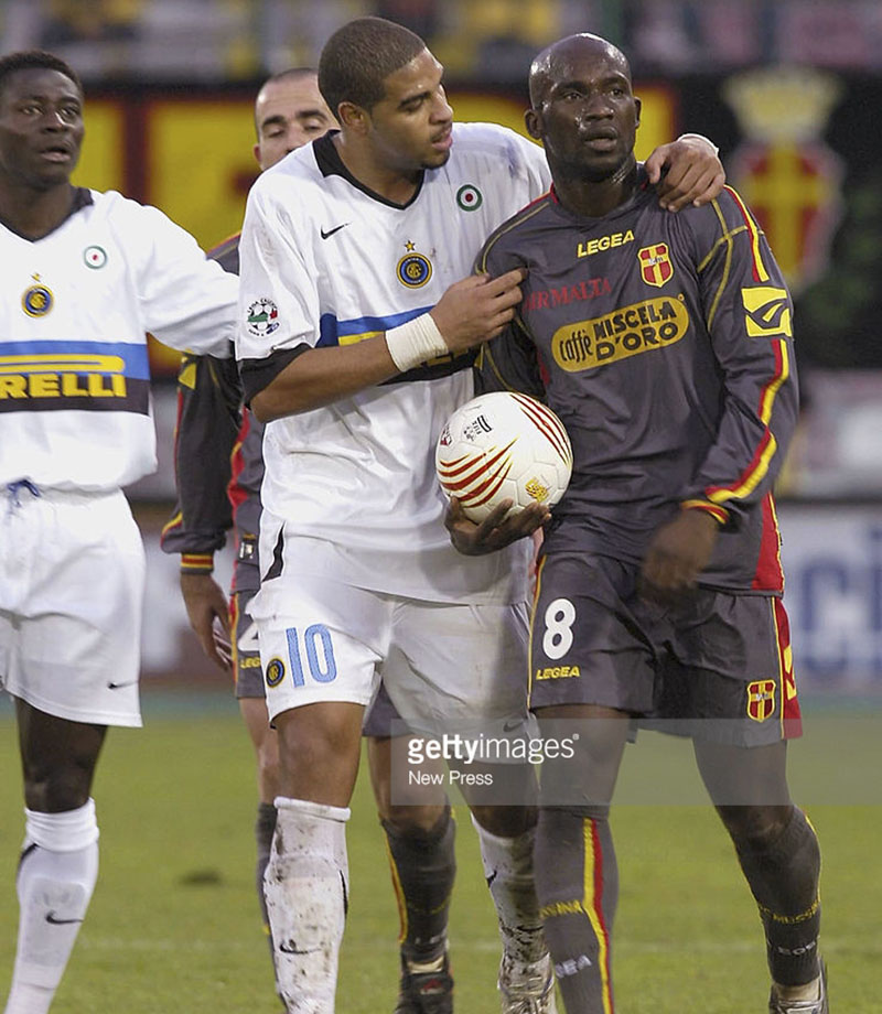 MESSINA, ITALY - NOVEMBER 27: Adriano of Inter Milan talks to Marco Andre Zoro of Messina during the Serie A match between Messina and Inter Milan at the Stadio San Filippo on November 27, 2005 in Messina, Italy. Zoro picked up the ball and threatened to walk off the pitch following racist abuse from the Inter Milan fans. (Photo by New Press/Getty Images)