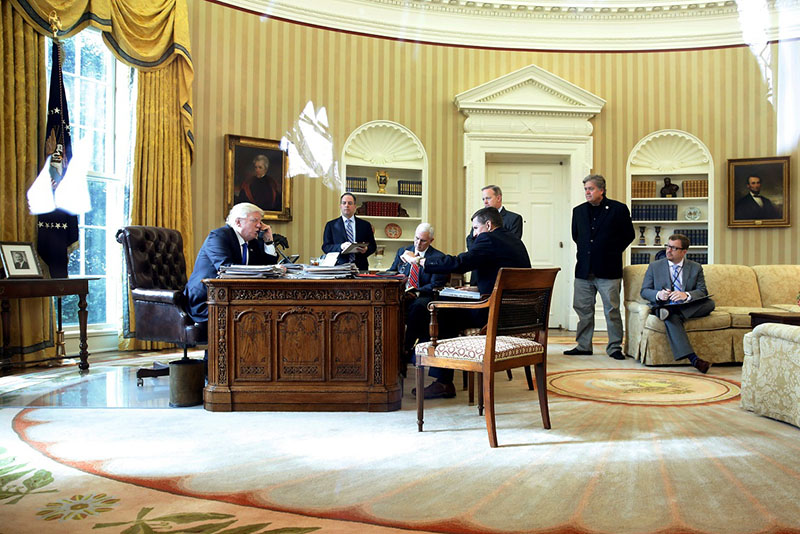 U.S. President Donald Trump (from L), joined by Chief of Staff Reince Priebus, Vice President Mike Pence, National Security Advisor Michael Flynn, Communications Director Sean Spicer and senior advisor Steve Bannon, speaks by phone with Russia's President Vladimir Putin in the Oval Office at the White House in Washington, U.S. January 28, 2017. REUTERS/Jonathan Ernst